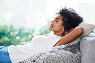Woman relaxing on couch